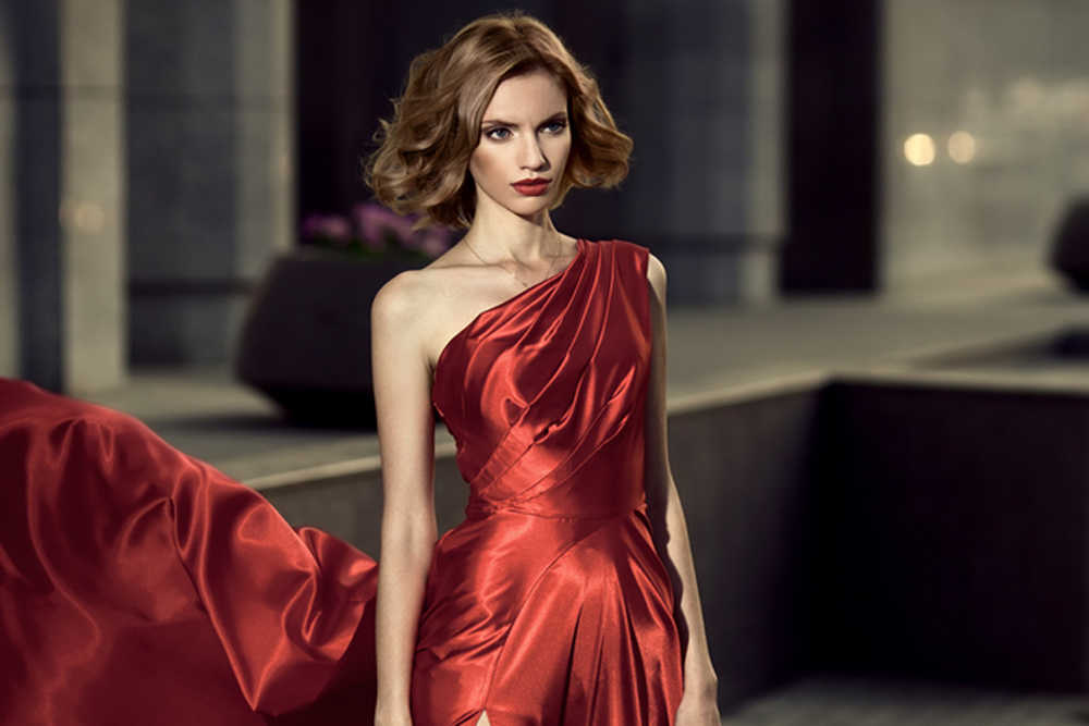 woman in red dress with short hair