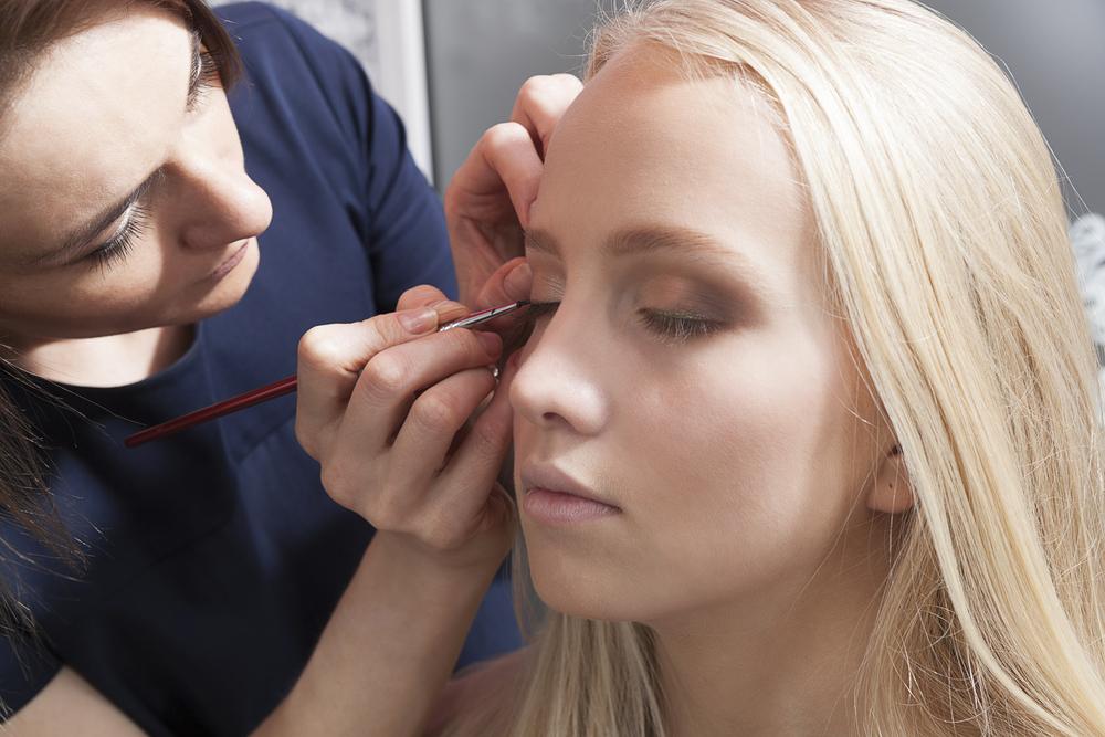 woman getting eye makeup