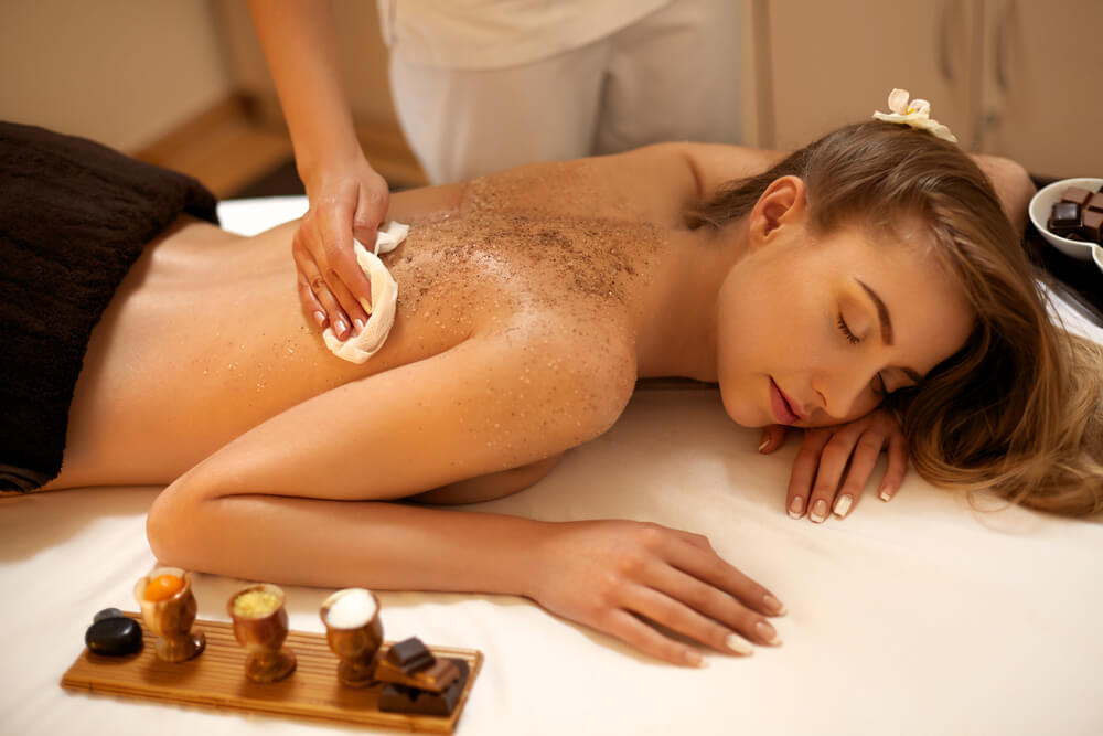 woman getting back scrub at spa