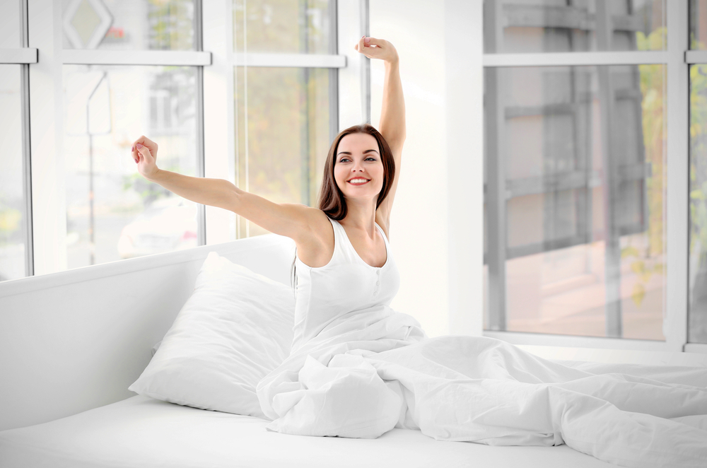 woman waking up happy