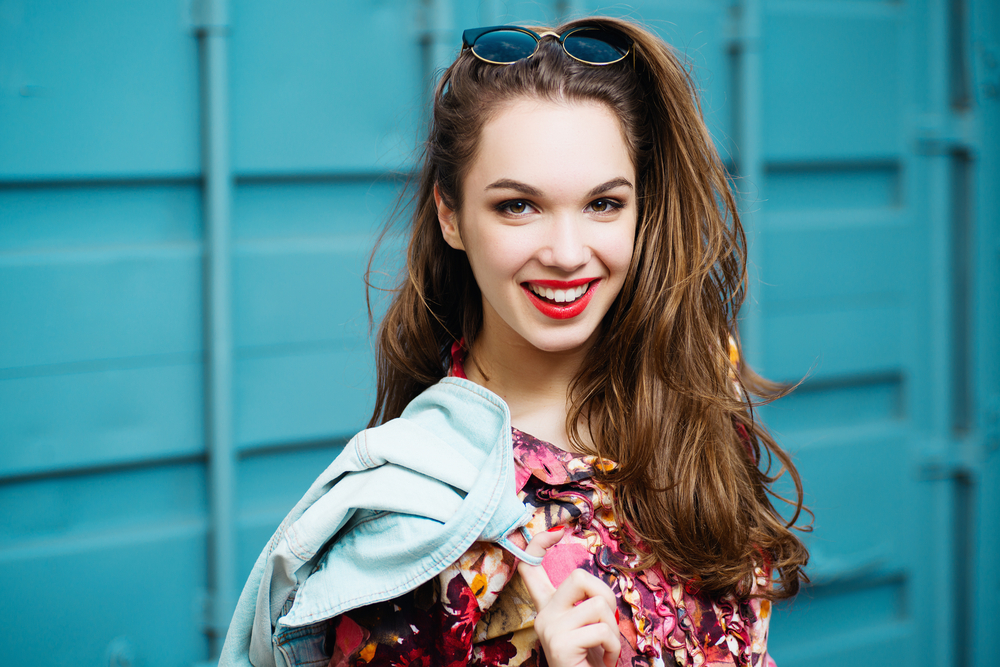 woman smiling with jean jacket